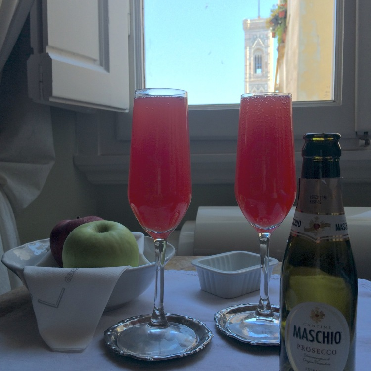 Blood orange mimosas with Giotto's Bell Tower