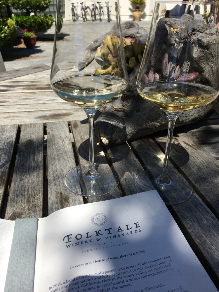 A pair of wine glasses and menu at folktale winery and vineyards