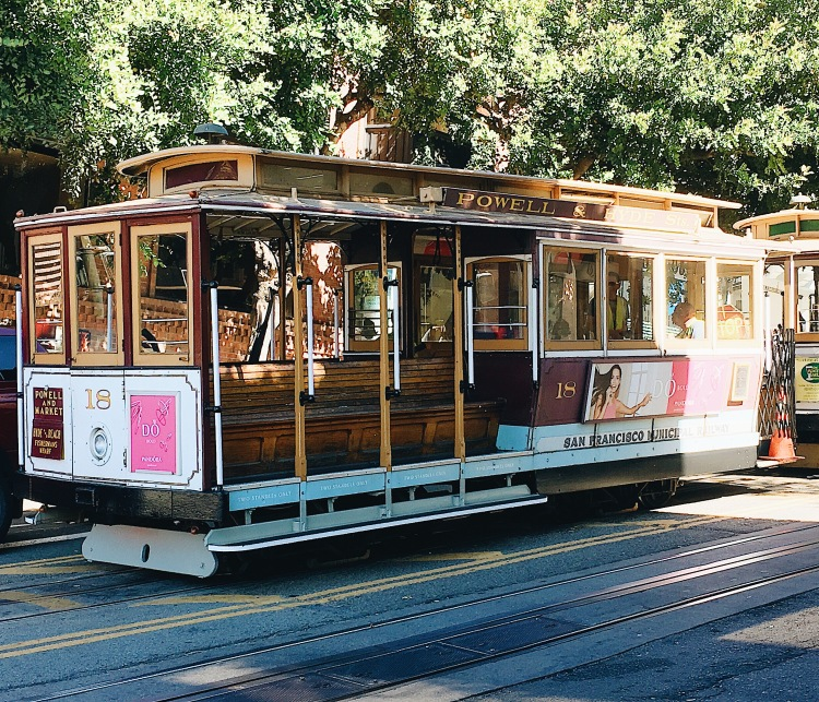 an historic cable car on the streets of san francisco