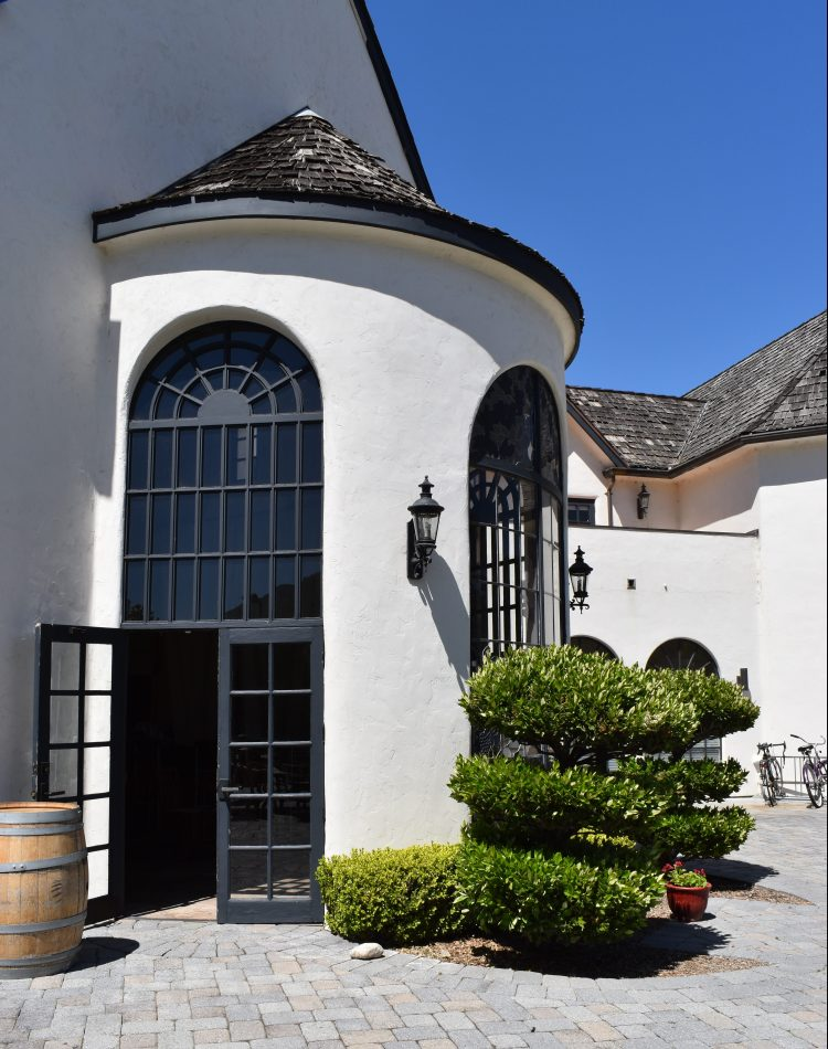 An open doorway leading into the inside tasting room at folktale winery and vineyards