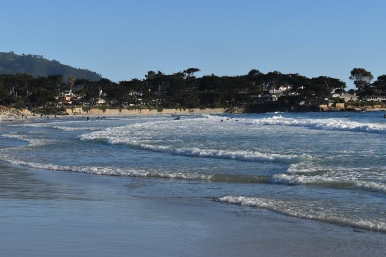 Waves crashing on the sand in carmel beach