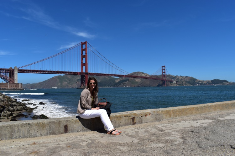Erin from Cathedrals and Cafes poses in front of the golden gate bridge