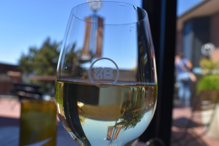 a glass of white wine from bluxome winery in ghirardelli square
