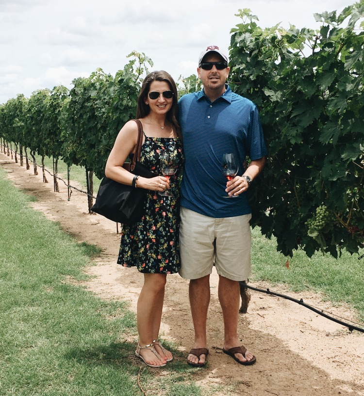 Erin from cathedrals and cafes with her husband at Grape Creek Vineyards in Fredericksburg Texas