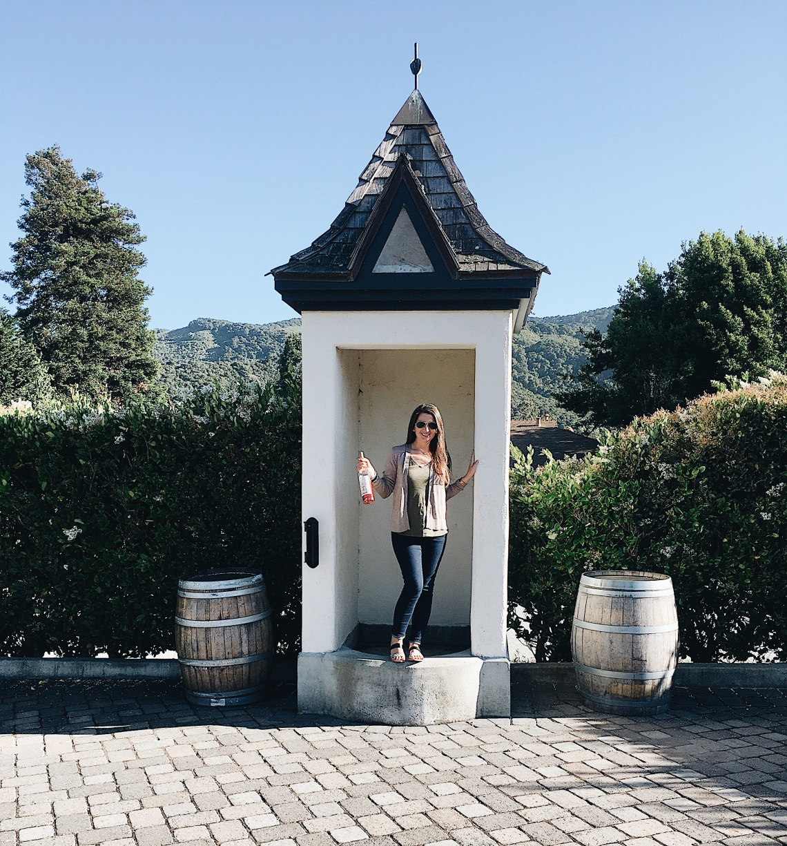 Erin from cathedrals and cafes poses in a small tower of folktale winery and vineyards