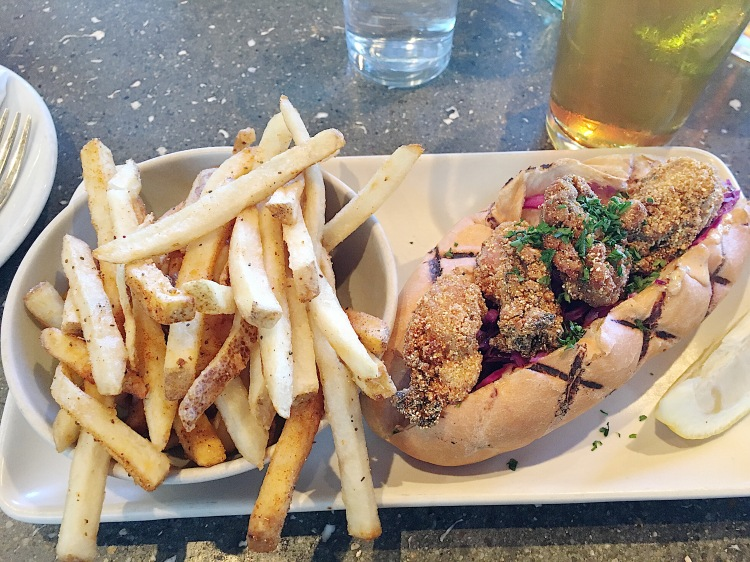 a fried oyster poboy and fries from hog island oyster company