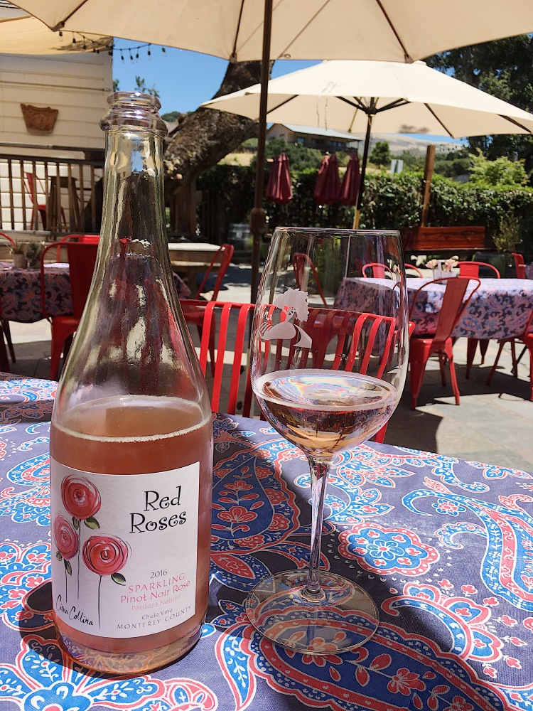 a bottle of sparkling rosé at cima collina winery in carmel valley village