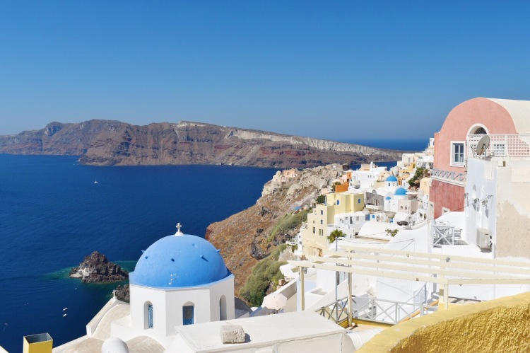 A view of blue domes and the sea in Santorini, Greece