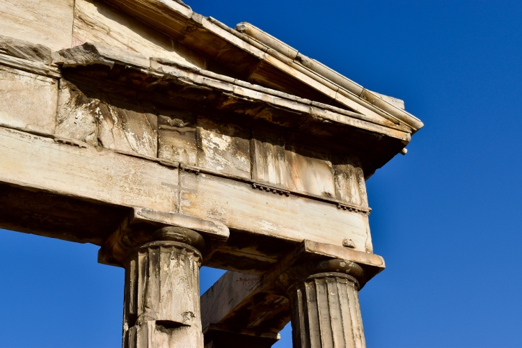 A closeup photo of the column details of the entrance to the Roman Agora in Athens, Greece