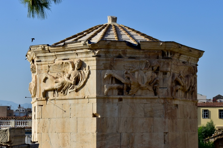 A closeup of the detailed reliefs in the Tower of the Winds in Athens, Greece