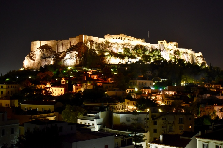 A view of the Acropolis at night from the Thea terrace bar in Athens, Greece.