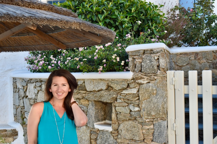 Erin from Cathedrals and Cafes Blog, wearing turquoise shift dress from Old Navy, posing poolside at Vencia Boutique Hotel Mykonos, Greece