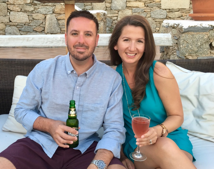 Erin from Cathedrals and Cafes Blog and her husband enjoying pre-dinner cocktails poolside at Vencia Boutique Hotel in Mykonos, Greece