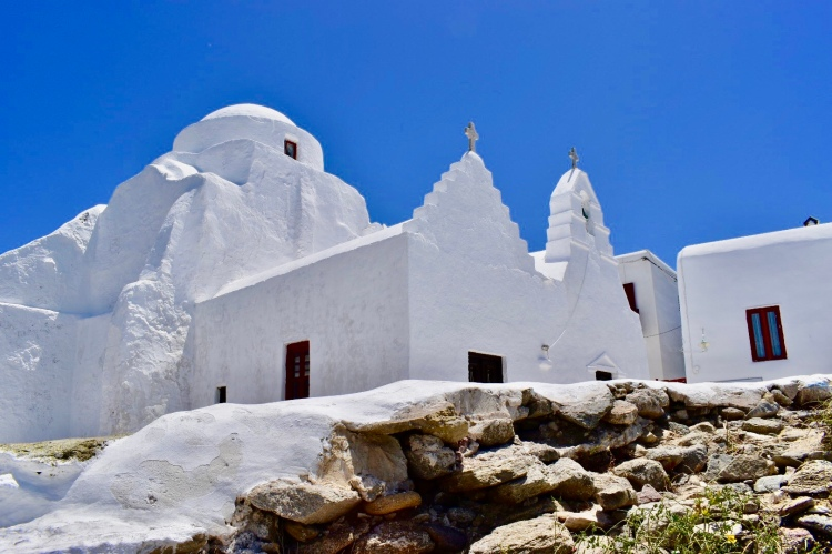 A pair of crosses atop a white chapel in Mykonos