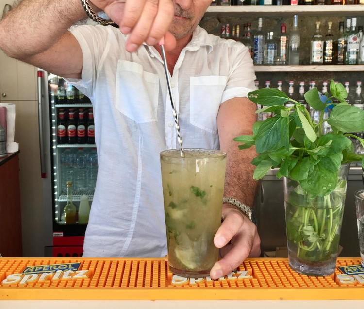 Bartender Dimitri making a mojito at the pool bar at Vencia Boutique Hotel in Mykonos Greece