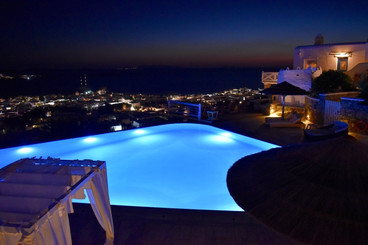 Night view of infinity pool at Vencia Boutique Hotel Mykonos
