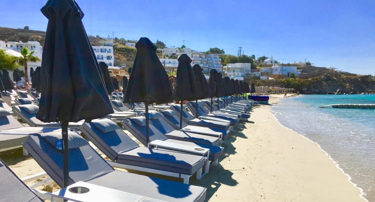Loungers and umbrellas at Platis Yialos Beach, Mykonos Greece