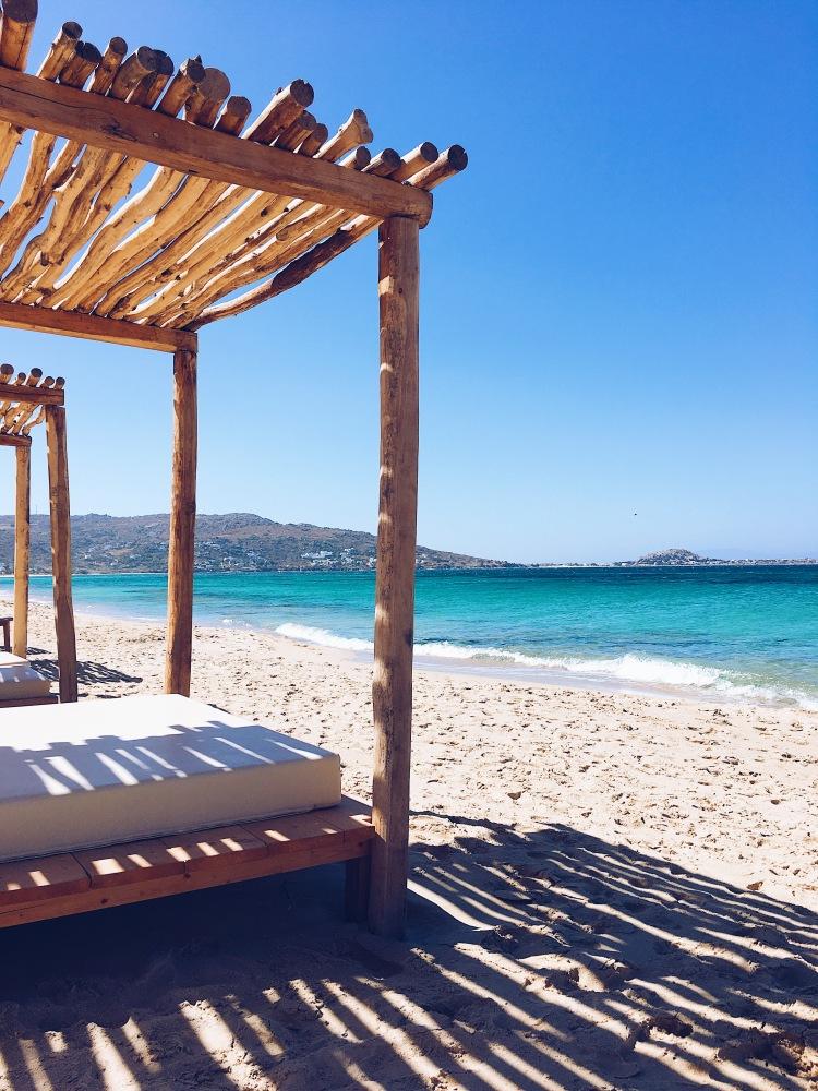 Lounge beds on Plaka Beach in Naxos Island, Greece