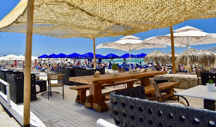A restaurant's outdoor terrace on Nissaki Beach in Naxos, Greece
