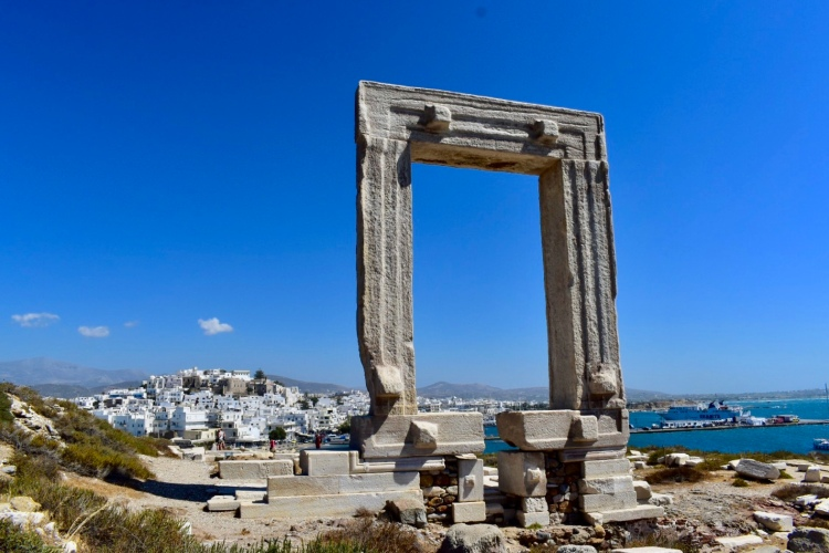 The Temple of Apollo, or Portara, with Naxos Town in the background in Naxos, Greece
