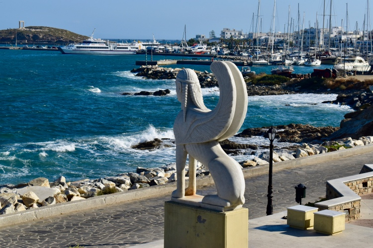 A sphynx statue facing the harbor in Naxos Greece