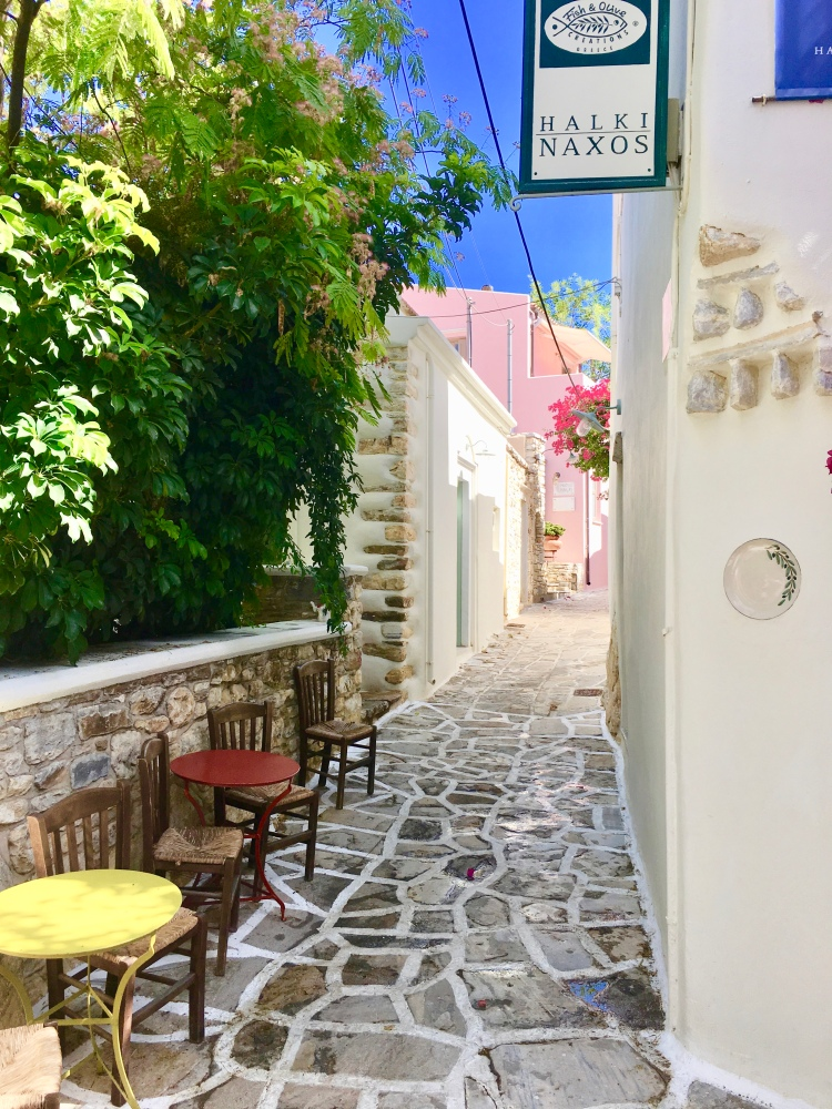 A color street with cafe chairs in Halki, Naxos Greece