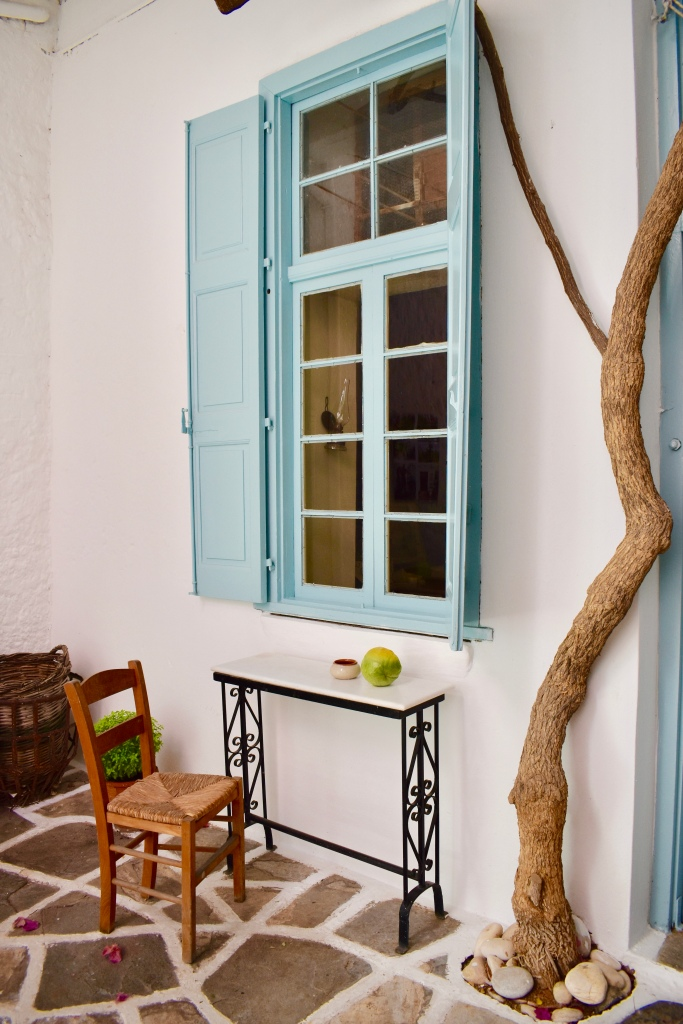 A blue window with desk and chair at Kitron Distillery in Halki, Naxos Greece