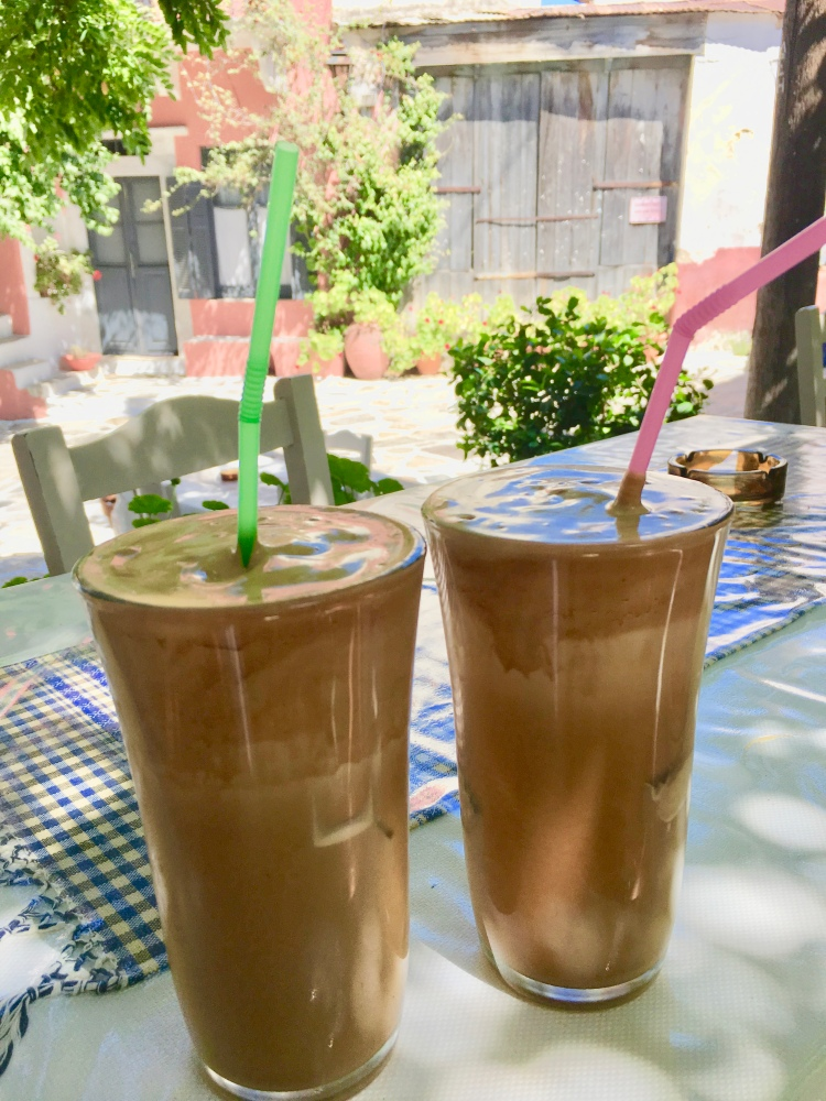 Two large glasses of Greek frappe at a cafe in Halki, Naxos Greece