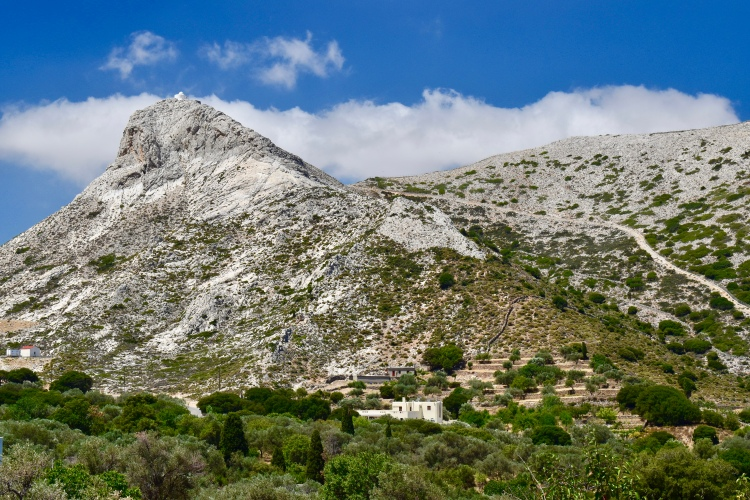 A view of a very large mountain with white chapel as seen from a cafe bar in Filoti, Naxos Greece