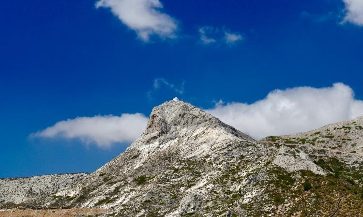 A view of a mountaintop white chapel in Filoti, Naxos Greece