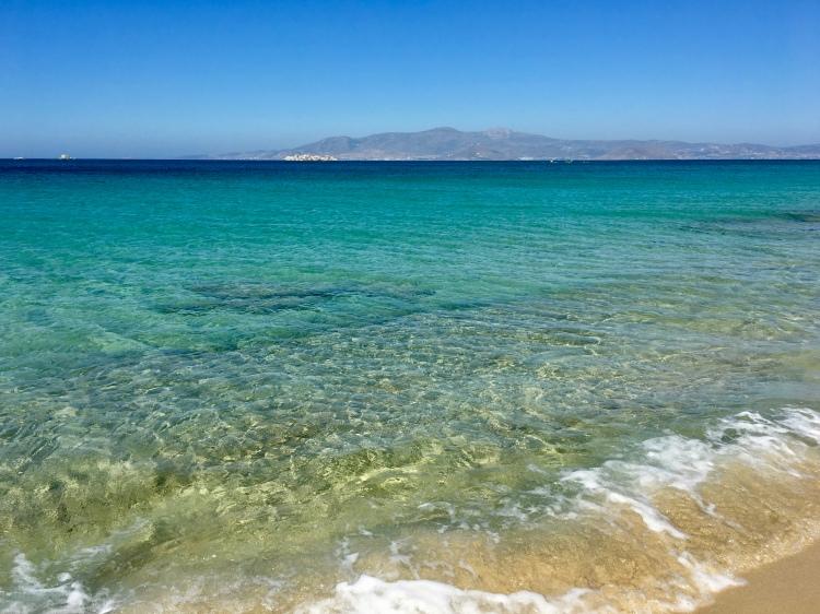Waves crashing on Plaka Beach in Naxos, Greece
