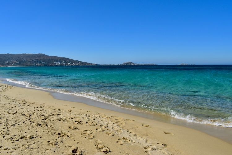 Golden sand and clear blue waters in Plaka Beach, Naxos Greece