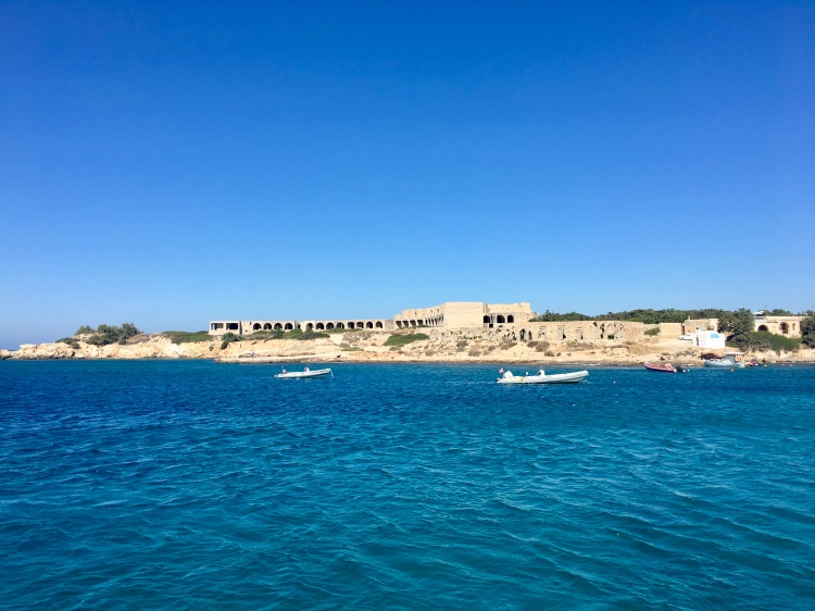 A view from the water of an abandoned resort hotel in Alyko, Naxos Greece