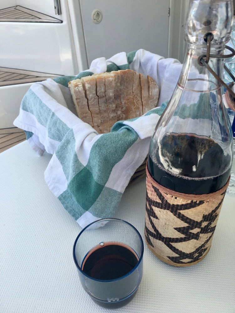 A large carafe of red wine aboard the catamaran Danae with Naxos Yachting in Naxos, Greece