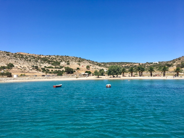 A view of boats along Panormos Beach in Naxos Greece