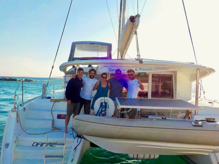 The crew poses for a picture aboard catamaran Danae with Naxos Yachting in Naxos, Greece