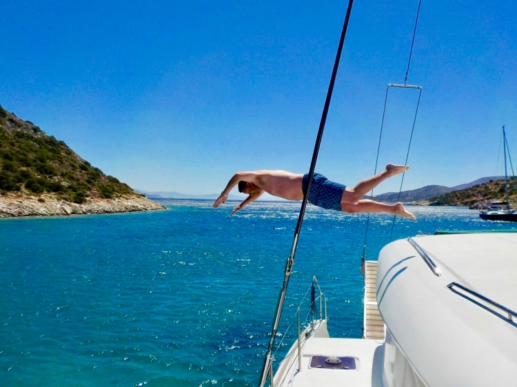 Erin's husband diving off catamaran Danae in Naxos, Greece