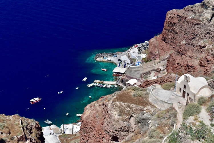 A view looking down at Ammoudi Bay in Oia Santorini Greece