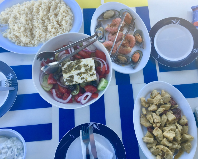 A traditional Greek lunch prepared aboard catamaran Tonina in Santorini Greece