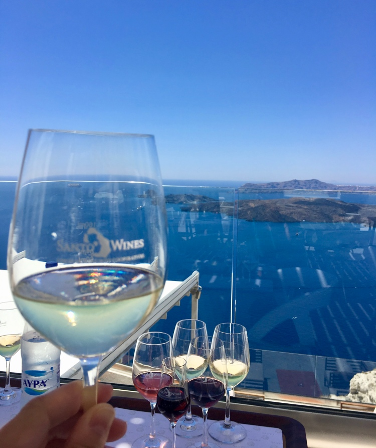 A glass of white wine at Santo Wines Winery in Santorini Greece