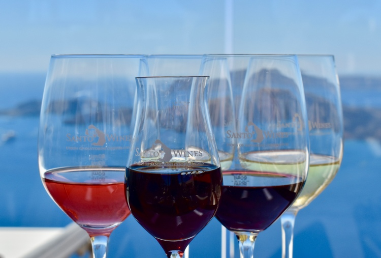 A selection of wines in logo wine glasses at Santo Wines Winery in Santorini Greece