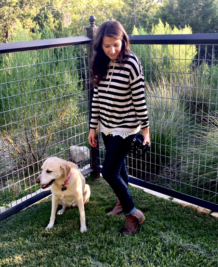 Erin from Cathedrals and Cafes blog stands in her backyard grass with her yellow labrador retriever