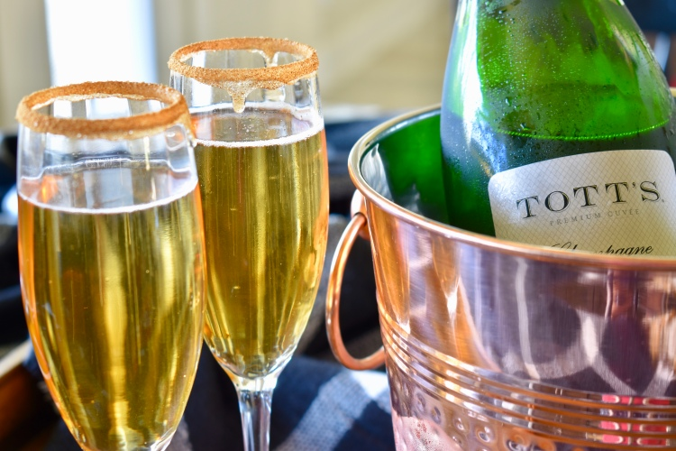 Tott's champagne and two flutes of apple cider mimosas from Cathedrals and Cafes blog recipe