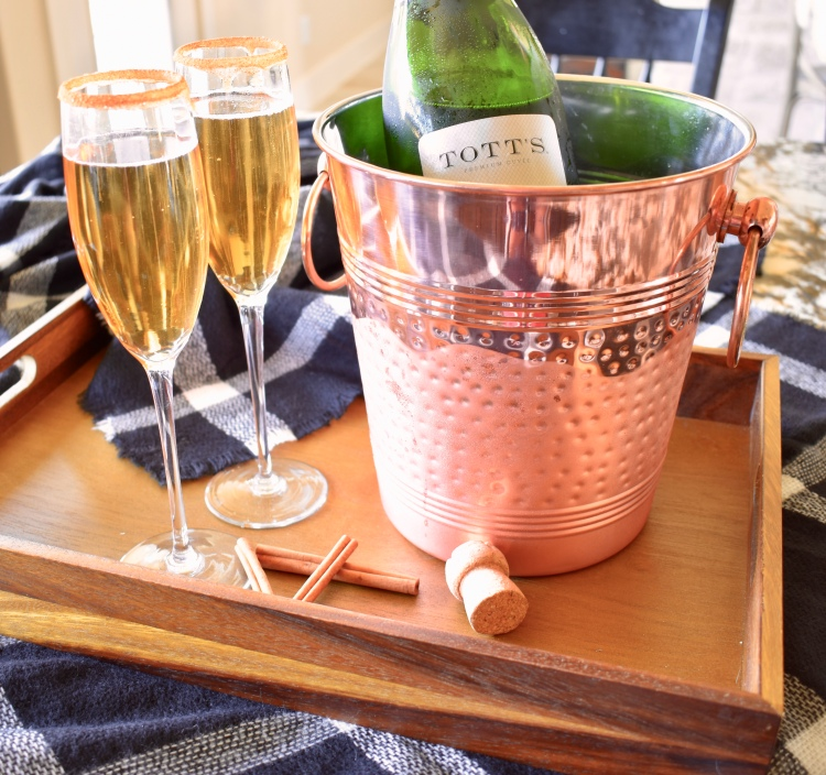 A tray of Tott's champagne and apple cider mimosas recipe