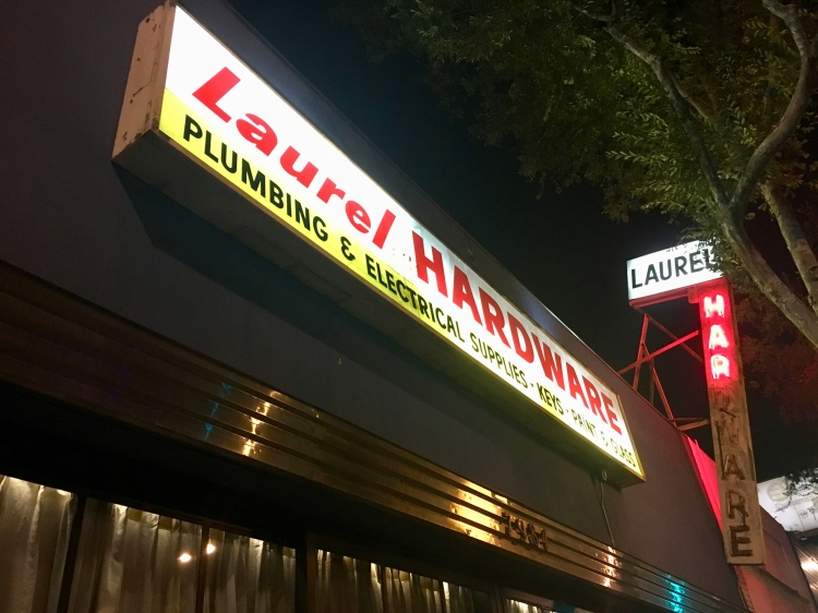 The signage for Laurel Hardware restaurant in West Hollywood is lit up brightly at night