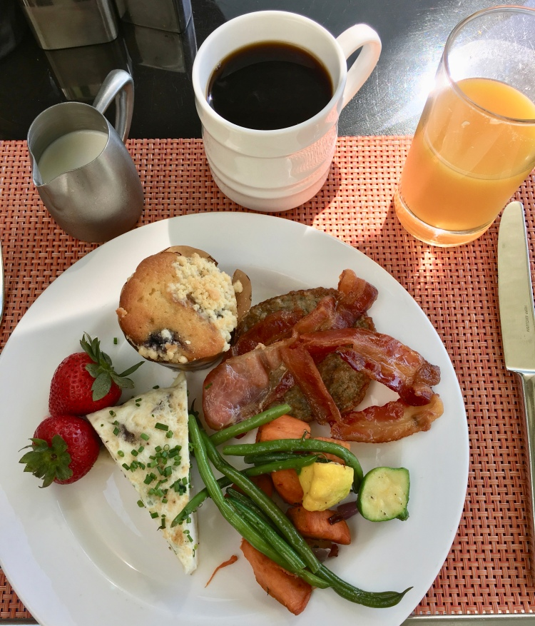 A plate of breakfast foods and coffee at The Beverly Hilton Hotel in Los Angeles California