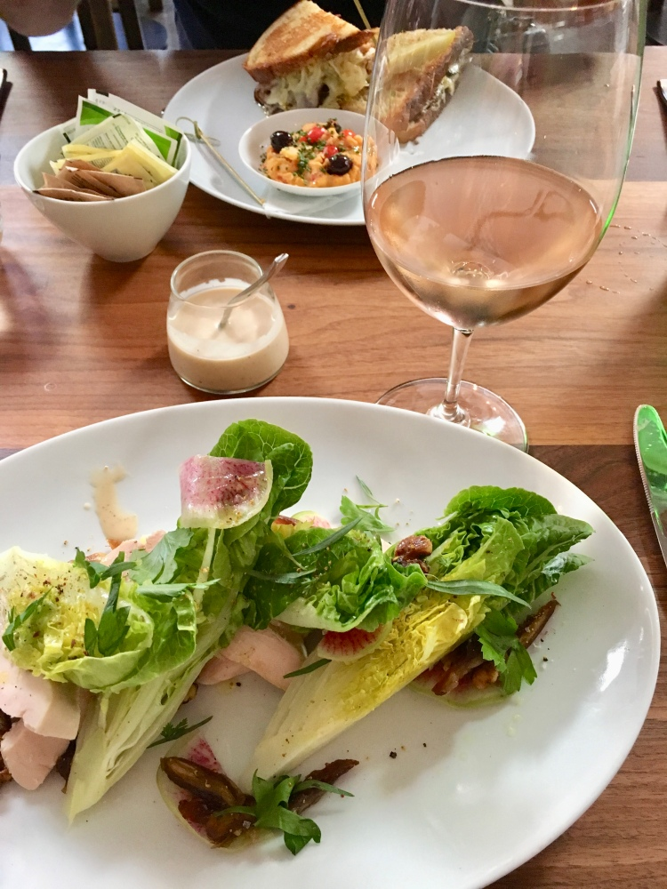 A lunch of chicken salad and Farmstrong Rosé wine at Brentwood Country Mart