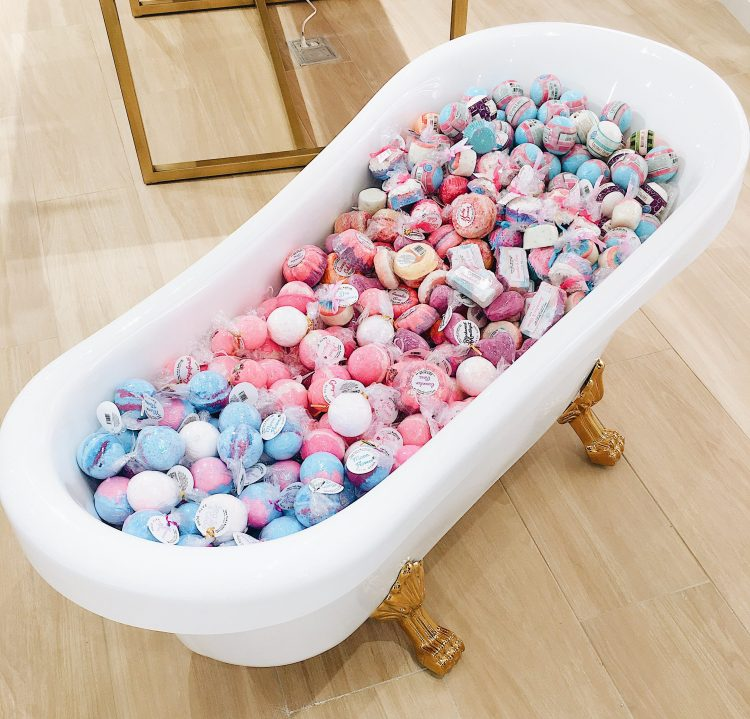 Clawfoot tub of bath bombs at Riley Rose Opening San Antonio with Cathedrals and Cafes Blog